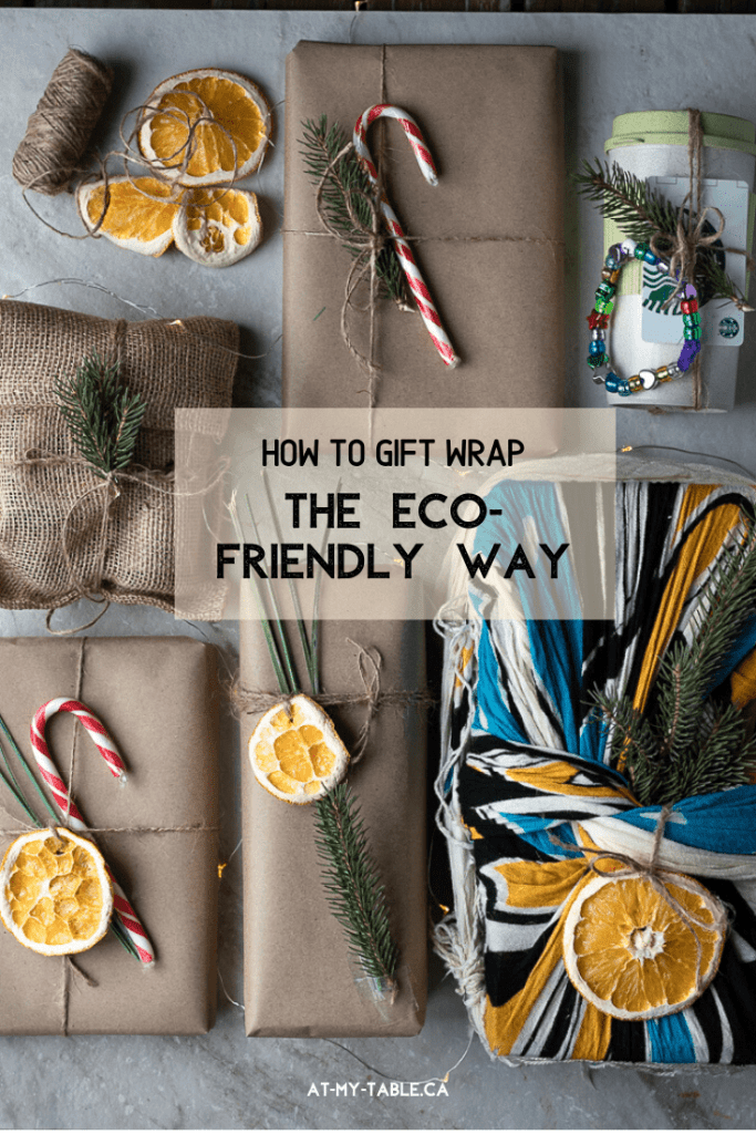 Eco-friendly wrapped present with candy canes and dry fruit as decoration