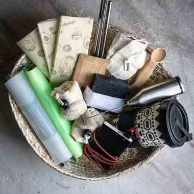wicker basket full of eco-friendly gift ideas