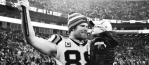 Greg Olsen Partners With Brand to Sell T-Shirts to Raise Money for The HEARTest Yard As Young Son Gets Heart Transplant