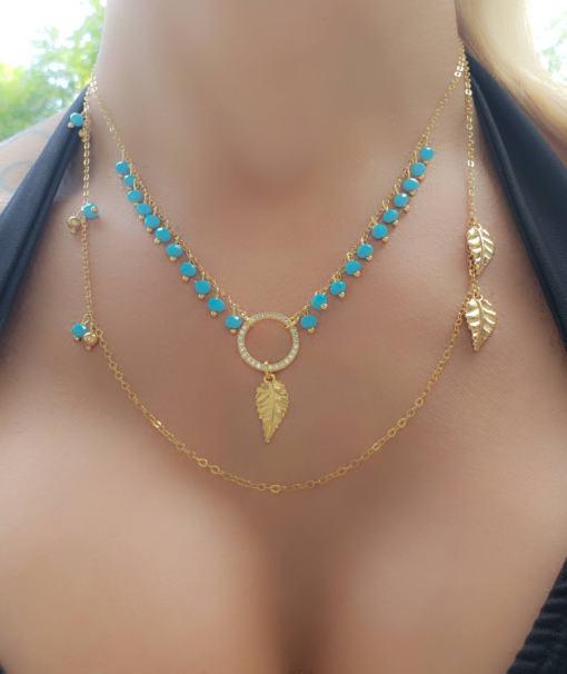 Colar 45cm com franja de cristal azul e mandala de zircônia branca com folha em banho de ouro 18k