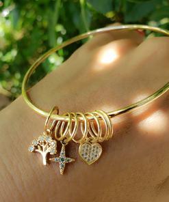 Bracelete com pingentes de Árvore, Estrela e Coração com micro zircônia branca em banho de ouro 18k