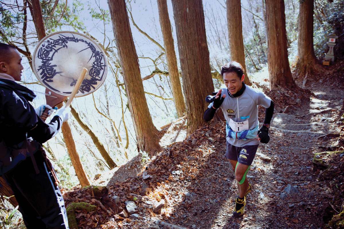 A chanting priest welcomes a runner climbing up Mt. Shichimen. Most hikers take four to five hours, but the runners did it in one hour.