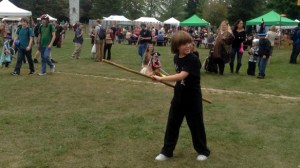 A young Shaolin demonstrates his skill with the staff