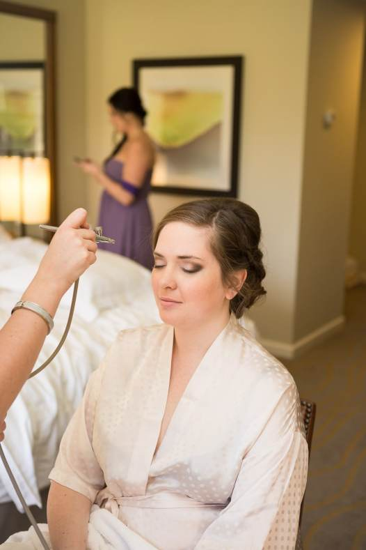 Airbrush makeup gives a polished look to the bride.