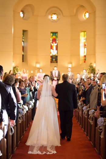 Father of the Bride walks his daughter down the aisle. The Woodlands Wedding Photographer.