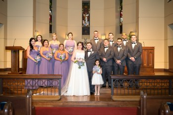 The full bridal party poses for a formal portrait after the ceremony by their photographer in The Woodlands.
