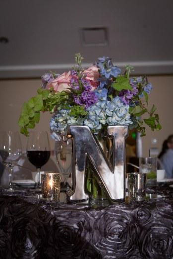 Mirrored monogram centerpiece at The Woodlands Resort Wedding