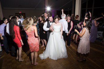 Bride and Groom dancing with their guests on The woodlands Resort dance floor.