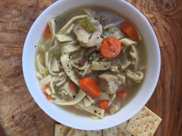 Bowl of Homemade Chicken Noodle Soup with Crackers