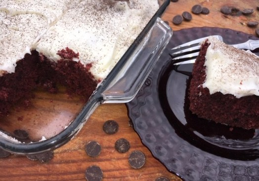 Red Velvet Brownies with cream cheese frosting in a glass baking dish.