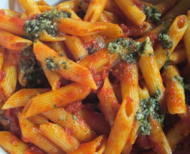Penne pasta with basil.