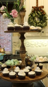 Tiered stand with cupcakes and goodies.