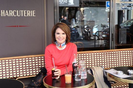Lorie at a French bistro in paris.