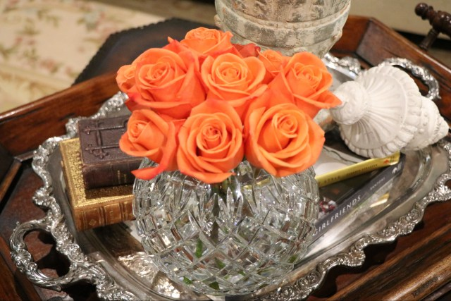 orange roses in a crystal bowl.