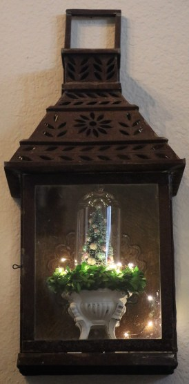 Metal lantern with Christmas decorations