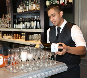 Waiter pouring champagne