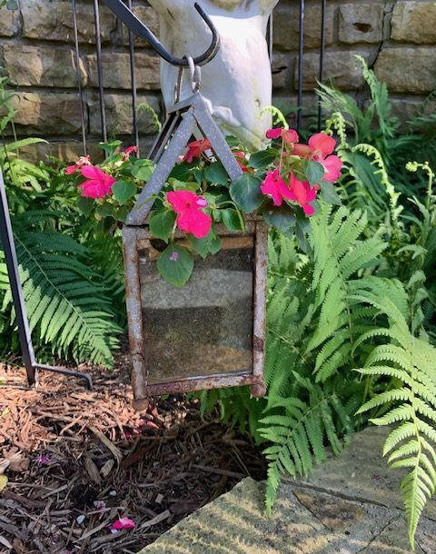 Lantern with pink flowers.