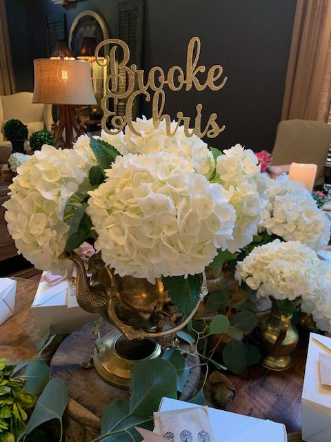 Hydrangeas arranged in silver tea pots