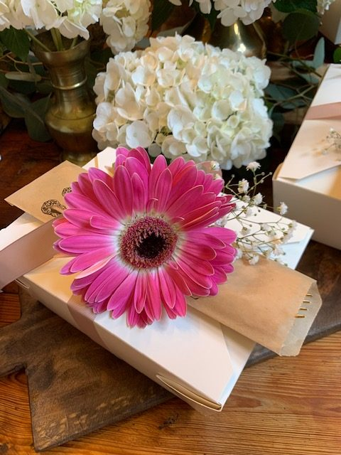 lunch box with Gerber daisy tied on top