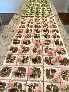 Rows and rows of appetizer boxes with flowers on top