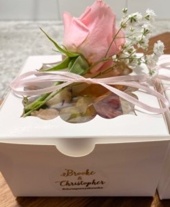 single appetizer box with rose on top for garnish