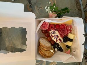 small appetizer box with cheese and fruits