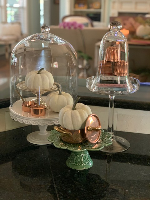 Fall decorating with pumpkins, copper and glass cloches.