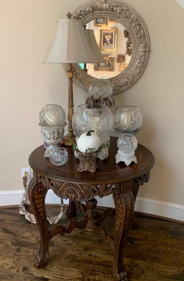 Fall decorating using pumpkins along with rose bowls.