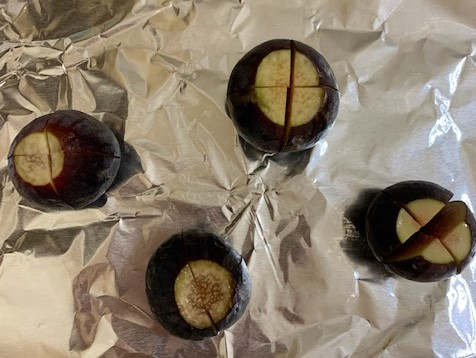 Appetizer Recipe for Stuffed Baked Figs, with the X cut into each fig