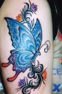 Very colorful arm butterfly tattoo design