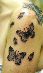 Very nic tattoo with some meaning, you can see butterflies and flower petals