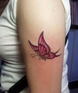 Detail and realistic pink butterfly tattoo on arm