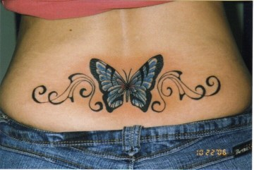 Blue butterfly tattoo design on the lower back