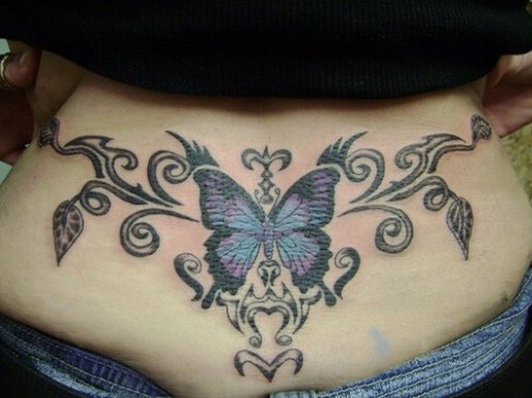 Butterfly is in center of the lower back surrounded by some black elemnts