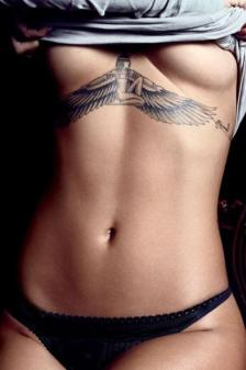 http://www.sortra.com/37-beautiful-under-breast-tattoo-designs/