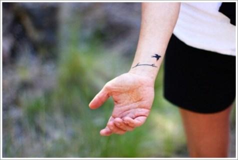 07 Black ink bird tattoo