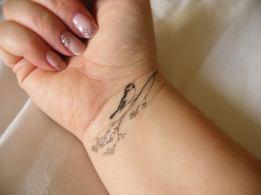 12 Very detailed bird tattoo