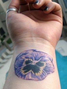purple flower wrist tattoo