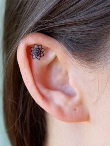 Cute Tattoo on ear http://tattoo-journal.com/25-best-ideas-for-ear-tattoo/