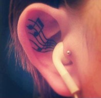 Cute music tattoo - music flowing from ear ;) http://www.tattoospictures.us/cute-ear-tattoos-for-girls.html