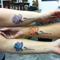 Colorful flower tattoos for sisters http://stayglam.com/life/sister-tattoos/