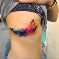 Beautiful Peter Pan rib tattoo. Instagram / fervescentattoo. http://stayglam.com/life/51-watercolor-tattoo-ideas-for-women/