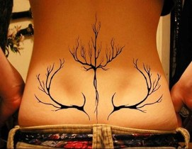 Unique lower back black lines tattoo https://www.inkdoneright.com/lower-back-tattoos/