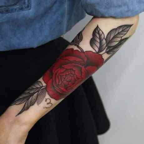 Pure red rose on arm tattoo