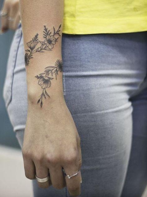 Black simple flower armband tattoo on wrist ideas