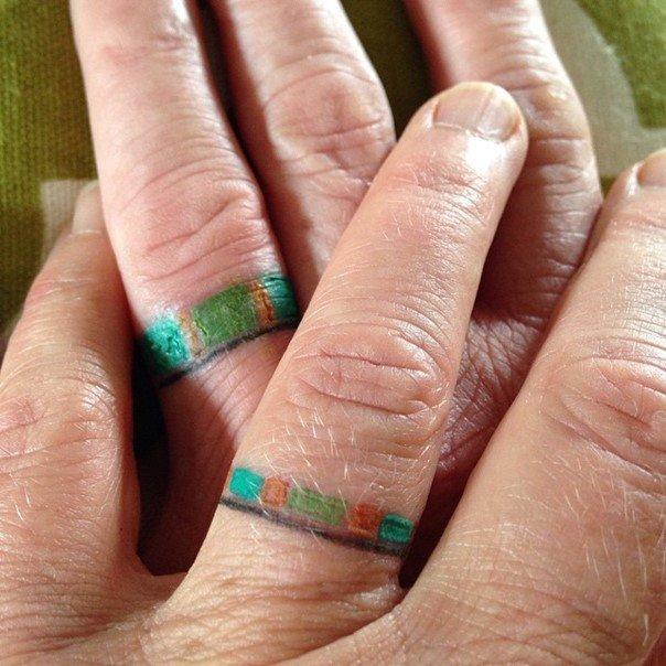 Colorful matching wedding ring tattoos