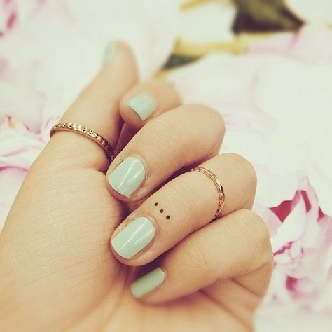 Dot subtle finger tattoos