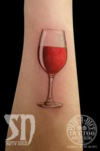 Glass of red wine on forearm tattoo ideas