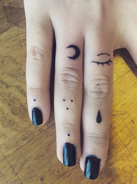 Moon eye and dots fingers tattoo