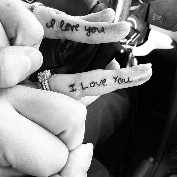 Wedding ring tattoo on finger